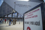 The entrance to the Mercedes-Benz Stadium Community Vaccination Center is seen in Atlanta, Tuesday, March 30, 2021. (Alyssa Pointer/Atlanta Journal-Constitution via AP)