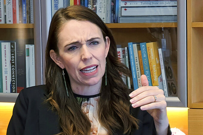 FILE - In this Dec. 16, 2020, file photo, New Zealand's Prime Minister Jacinda Ardern speaks during an interviewed in her office at the parliament in Wellington, New Zealand. Tentative plans for a movie that recounts the response of Ardern to a gunman's slaughter of Muslim worshippers drew criticism in New Zealand on Friday, June 11, 2021 for not focusing on the victims of the attacks. (AP Photo/Sam James, File)