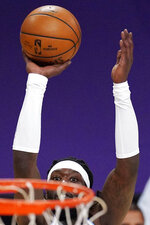 Los Angeles Lakers center Montrezl Harrell shoots during the first half of an NBA basketball game against the Washington Wizards Monday, Feb. 22, 2021, in Los Angeles. (AP Photo/Mark J. Terrill)