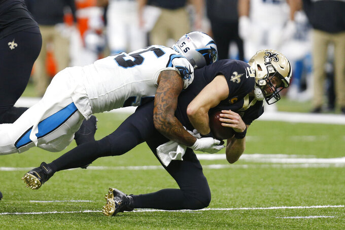 New Orleans Saints quarterback Drew Brees (9) is sacked by Carolina Panthers linebacker Bruce Irvin (55), during the first half at an NFL football game, Sunday, Nov. 24, 2019, in New Orleans. (AP Photo/Butch Dill)