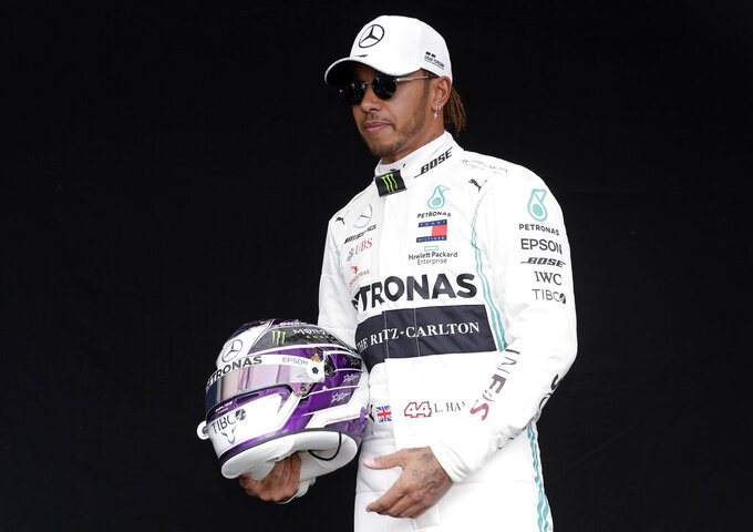 Mercedes driver Lewis Hamilton of Britain poses for a photo at the Australian Formula One Grand Prix in Melbourne, Thursday, March 12, 2020. (AP Photo/Rick Rycroft)