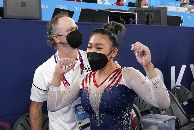 CORRECTS COACHE'S NAME TO JESS NOT JEFF - Sunisa Lee, of the United States, celebrates with her coach Jess Graba after she won the gold medal in the artistic gymnastics women's all-around at the 2020 Summer Olympics, Thursday, July 29, 2021, in Tokyo. (AP Photo/Gregory Bull)