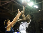 Washington forward Isaiah Stewart (33) shoots over San Diego forward Alex Floresca during the first half of an NCAA college basketball game, Sunday, Nov. 24, 2019, in Seattle. (Joshua Bessex/The News Tribune via AP)