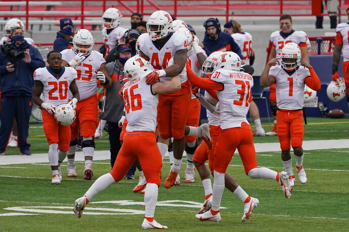 Illinois linebacker Tarique Barnes (44) celebrates with teammates after he intercepted a pass by Nebraska quarterback Luke McCaffrey during the first half of an NCAA college football game in Lincoln, Neb., Saturday, Nov. 21, 2020. (AP Photo/Nati Harnik)
