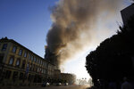 Smoke billows from a building on fire in Milan, Italy, Sunday, Aug. 29, 2021. (AP Photo/Luca Bruno)