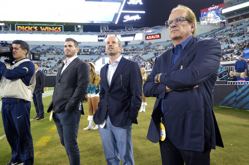 FILE - In this Sunday, Dec. 8, 2019, file photo, Los Angeles Chargers Chairman of the Board Dean Spanos, right, president of business operations A.G. Spanos, center, and personnel assistant Michael Spanos II watch from the sideline during the second half of an NFL football game against the Jacksonville Jaguars, in Jacksonville, Fla. In a petition filed Thursday, April 1, 2021, in Los Angeles County Superior Court, the sister of Chargers controlling owner Dean Spanos is petitioning a California state court to put one-third of the team's ownership stake up for sale. (AP Photo/Phelan M. Ebenhack, File)