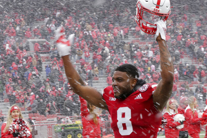 In this Nov. 17, 2018 photo, Nebraska wide receiver Stanley Morgan Jr. (8) celebrates a 9-6 win over Michigan State in an NCAA college football game in Lincoln, Neb. Scott Frost's first Nebraska team is in position to finish with one more win than the Mike Riley-led Cornhuskers had a year ago. That would be no small accomplishment for the Huskers, who were the last power-five conference team to win this season following a program-worst 0-6 start. (AP Photo/Nati Harnik)