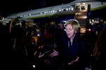 Democratic presidential candidate Sen. Elizabeth Warren, D-Mass., speaks to members of the media as she arrives at the Manchester-Boston Regional Airport in Manchester, N.H., Tuesday, Feb. 4, 2020, after traveling from Des Moines, Iowa following the Iowa caucus. (AP Photo/Andrew Harnik)