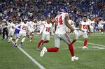 Teammates rush to congratulate New York Giants wide receiver Alonzo Russell (84) after he caught a touchdown pass to win an NFL preseason football game against the New England Patriots, Thursday, Aug. 29, 2019, in Foxborough, Mass. (AP Photo/Elise Amendola)