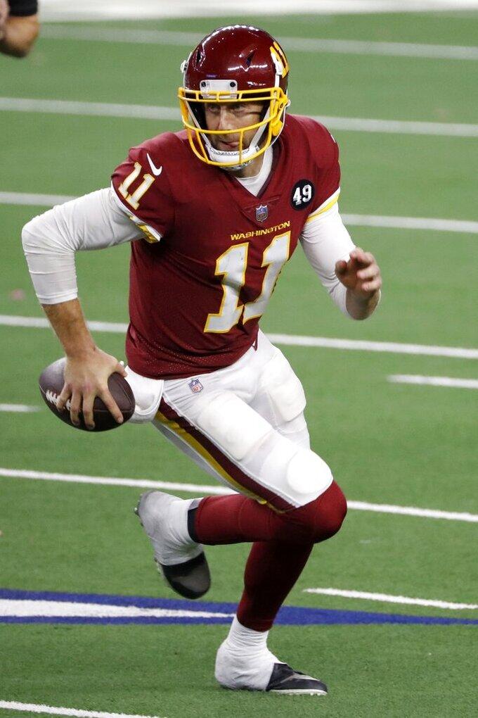 Washington Football Team quarterback Alex Smith (11) runs the ball in the second half of an NFL football game against the Dallas Cowboys in Arlington, Texas, Thursday, Nov. 26, 2020. (AP Photo/Roger Steinman)