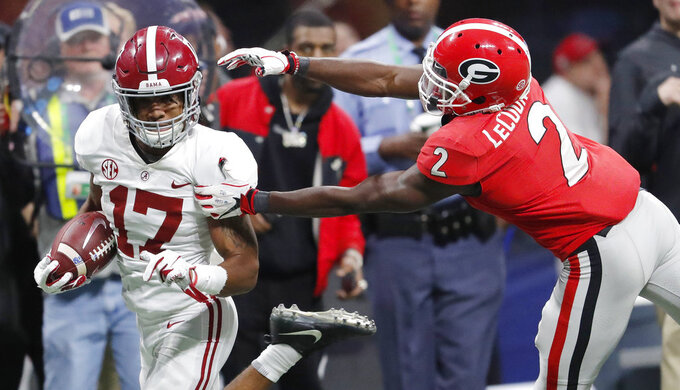 Georgia defensive back Richard LeCounte (2) misses Alabama wide receiver Jaylen Waddle (17) during the second half of the Southeastern Conference championship NCAA college football game, Saturday, Dec. 1, 2018, in Atlanta. (AP Photo/John Bazemore)