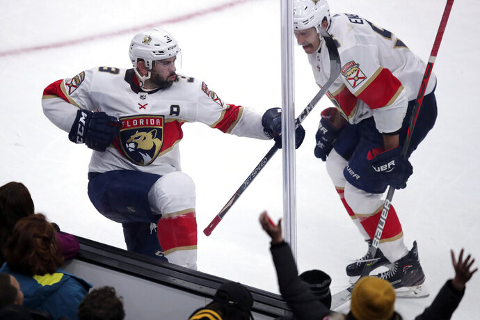 Florida Panthers defenseman Keith Yandle, left, celebrates after his third period goal, which tied the game at 4-4, during an NHL hockey game against the Boston Bruins in Boston, Tuesday, Nov. 12, 2019. (AP Photo/Charles Krupa)