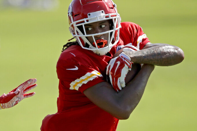 Kansas City Chiefs wide receiver Demarcus Robinson catches a pass during NFL football training camp Monday, July 29, 2019, in St. Joseph, Mo. (AP Photo/Charlie Riedel)