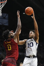 Butler's Bryce Nze (10) puts up a shot over Louisiana Monroe's Chris Efretuei (0) during the first half of an NCAA college basketball game, Saturday, Dec. 28, 2019, in Indianapolis. (AP Photo/Darron Cummings)