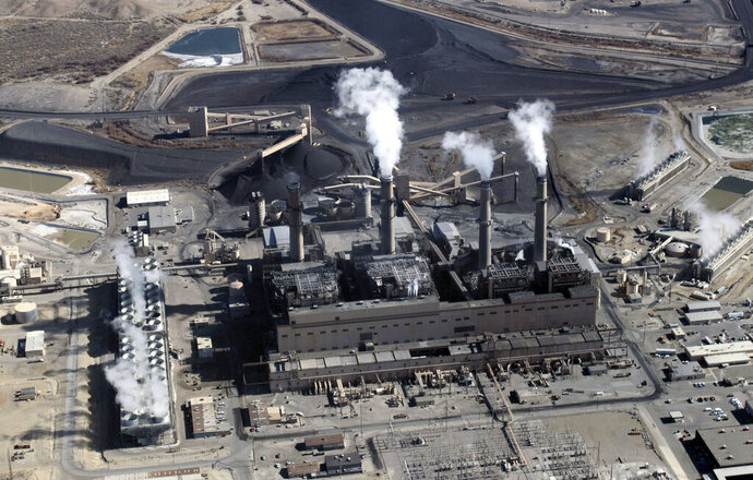 FILE - This Nov. 9, 2009, file photo, shows the coal-fired San Juan Generating Station near Farmington, N.M. The utility Public Service Company of New Mexico is looking to its future as it readies to end operations at the San Juan Generating Station. (AP Photo/Susan Montoya Bryan, File)