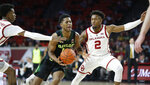 Baylor guard Jared Butler, center, drives between Oklahoma guard Jamal Bieniemy, left, and guard Aaron Calixte (2) in the first half of an NCAA college basketball game in Norman, Okla., Monday, Jan. 28, 2019. (AP Photo/Sue Ogrocki)