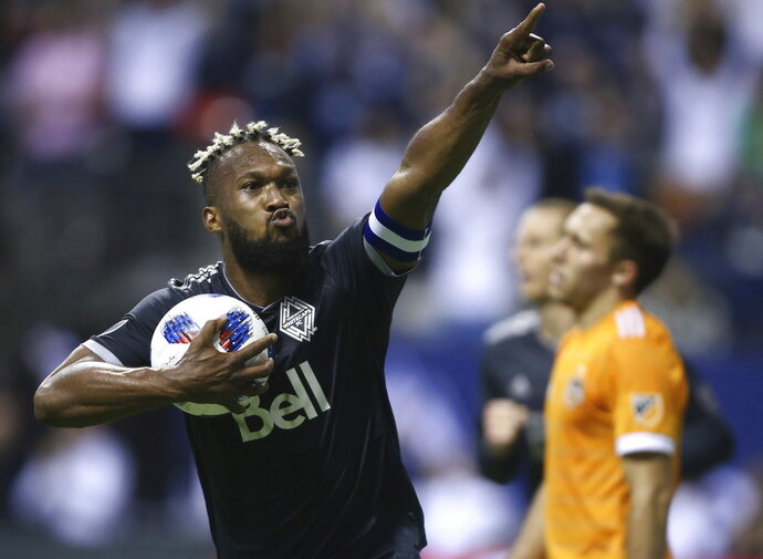 FILE - In this Friday, May 11, 2018, file photo, Vancouver Whitecaps defender Kendall Waston celebrates his goal against the Houston Dynamo during the second half of an MLS soccer match in Vancouver, British Columbia. Waston was selected for Cost Rica's 23-man roster for the World Cup in Russia.  (Ben Nelms/The Canadian Press via AP, File)