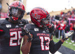 Arkansas State's Trent Ellis-Brewer (26) and Kirk Merritt (13) celebrate after Merritt returned a kickoff 94-yards for a touchdown during the second quarter of during an NCAA college football game against Georgia Southern, Saturday, Nov. 23, 2019, at Centennial Bank Stadium in Jonesboro, Ark. (Quentin Winstine/The Jonesboro Sun via AP)