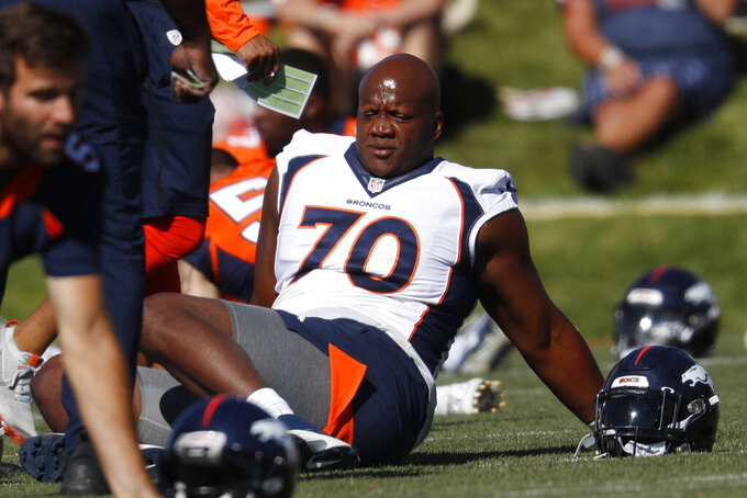 FILE - In this July 19, 2019, file photo, Denver Broncos offensive tackle Ja'Wuan James (70) stretches during NFL football training camp in Englewood, Colo. James filed a $15 million grievance Monday, June 7, 2021, against the Broncos, who released him last month after he ruptured an Achilles during an off-site workout. (AP Photo/David Zalubowski, File)