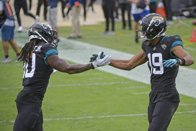 Jacksonville Jaguars wide receiver Collin Johnson (19) celebrates his touchdown reception against the Cleveland Browns with teammate wide receiver Laviska Shenault Jr., left, during the first half of an NFL football game, Sunday, Nov. 29, 2020, in Jacksonville, Fla. (AP Photo/Phelan M. Ebenhack)
