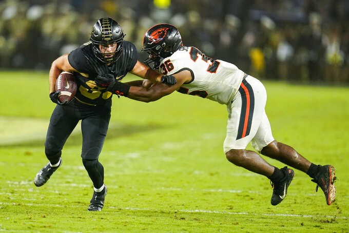 Purdue wide receiver Jackson Anthrop (33) is tackled by Oregon State linebacker Omar Speights (36) during the first half of an NCAA college football game in West Lafayette, Ind., Saturday, Sept. 4, 2021. (AP Photo/Michael Conroy)