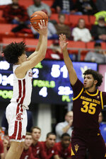 Washington State forward CJ Elleby, left, shoots over Arizona State forward Taeshon Cherry during the second half of an NCAA college basketball game in Pullman, Wash., Wednesday, Jan. 29, 2020. Washington State won 67-65. (AP Photo/Young Kwak)