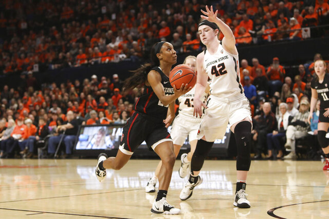Stanford's Kiana Williams (23) drives to the basket past Oregon State's Kennedy Brown (42) during the first half of an NCAA college basketball game in Corvallis, Ore., Sunday, Jan. 19, 2020. (AP Photo/Amanda Loman)