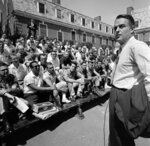 "FILE - Sargent Shriver, head of the Peace Corps, addresses some of the volunteers destined for Colombia, as they started their training at Rutgers University in New Brunswick, N.J., on June 25, 1961. RosettaBooks announced Tuesday, July 7, 2020, that it had acquired Shriver's memoir ""We Called It a War,"" which he worked on in the late 1960s and was only recently rediscovered. Shriver's friend and law partner David Birenbaum edited the manuscript, in which Shriver tells of his efforts to fulfill Johnson's vow in 1964 to end poverty. The 348-page book, pared down from a ""very raw"" 500 pages, is scheduled for January. Shriver died Jan. 18, 2011 at age 95.  (AP Photo, File)"