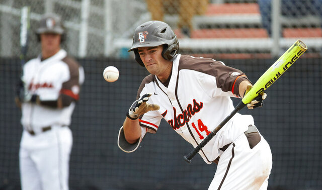 FILE - In this May 10, 2019, file photo, Bowling Green's Neil Lambert bats during the team's NCAA college baseball game against Kent Sate in Bowling Green, Ohio. Bowling Green recently announced that it is dropping baseball. Colleges mulling whether to cut sports amid the coronavirus pandemic must ensure they remain compliant with the federal civil-rights law known as Title IX, which requires the equitable treatment of remaining men's and women's programs. (AP Photo/Rick Osentoski, File)