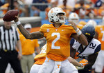 Tennessee's Jarrett Guarantano (2) looks to pass against West Virginia in the first half of an NCAA college football game in Charlotte, N.C., Saturday, Sept. 1, 2018. (AP Photo/Chuck Burton)