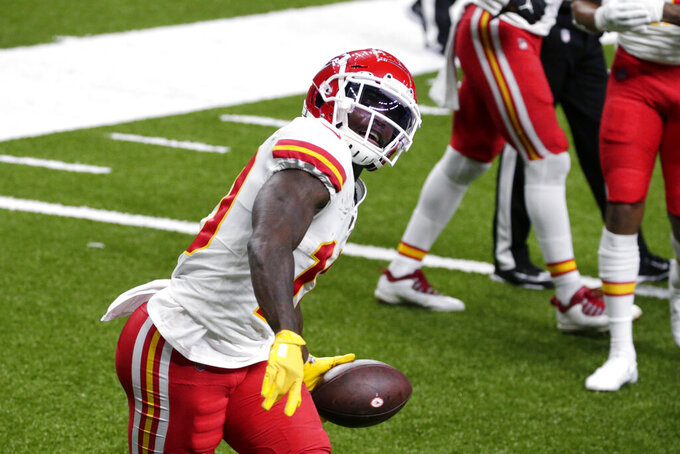 Kansas City Chiefs wide receiver Tyreek Hill celebrates his touchdown reception in the first half of an NFL football game against the New Orleans Saints in New Orleans, Sunday, Dec. 20, 2020. (AP Photo/Butch Dill)