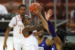 Texas guard Andrew Jones (1) shoots over TCU guard PJ Fuller (4) during the first half of an NCAA college basketball game, Saturday, Feb. 13, 2021, in Austin, Texas. (AP Photo/Eric Gay)