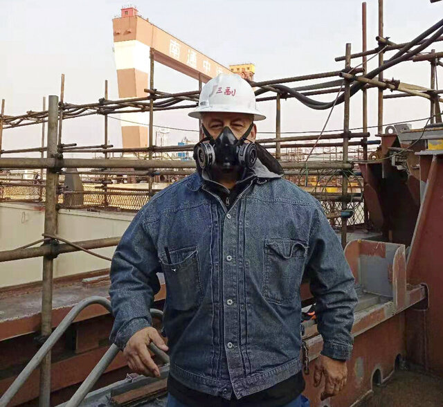 In this Dec. 16, 2020, photo released by Harvey Smith, he poses for a photo as he makes his round on the U.S.-owned Horizon Spirit getting overhauled at the dock in Nantong, eastern China's Jiangsu Province. The crew of the Horizon Spirit plan to spend Christmas looking after their 800-foot (240-meter) long container ship in a southern Chinese shipyard while they are barred, like thousands of sailors worldwide, from going ashore due to coronavirus restrictions. (Harvey Smith via AP)