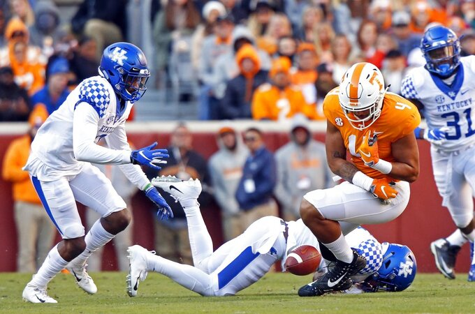Tennessee tight end Dominick Wood-Anderson (4) can't hold onto the ball as he's hit by Kentucky safety Mike Edwards (7) in the first half of an NCAA college football game Saturday, Nov. 10, 2018, in Knoxville, Tenn. Edwards was injured on the play. (AP Photo/Wade Payne)