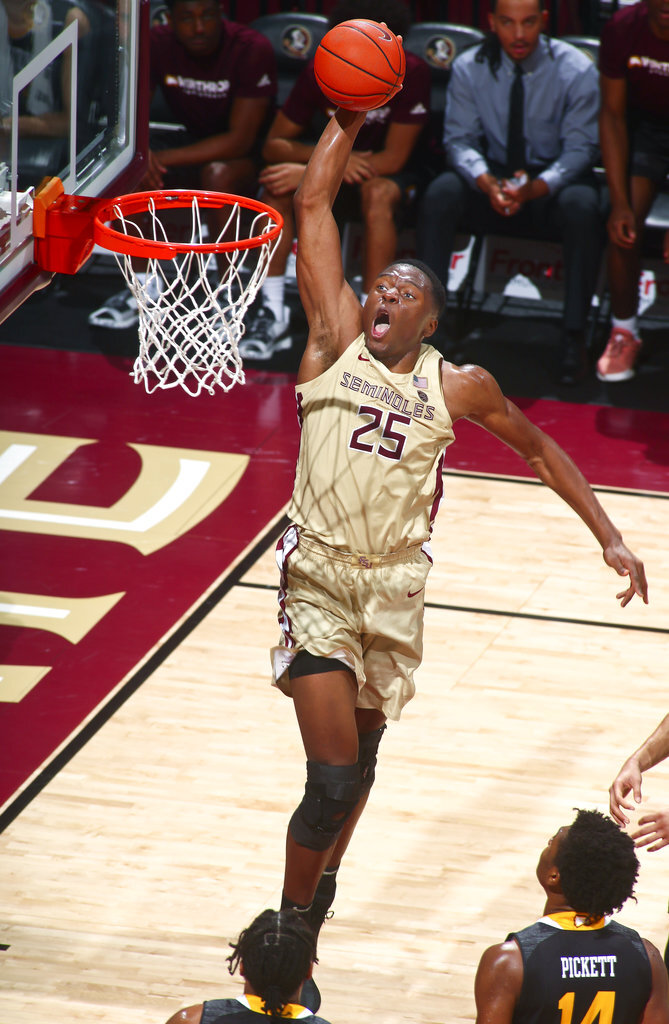 Florida State forward Mfiondu Kabengele (25) slam dunks the ball as Winthrop guard Adam Pickett (14) watches from below in the first half of an NCAA college basketball game in Tallahassee, Fla., Tuesday, Jan. 1, 2019. Florida State won 87-76. (AP Photo/Phil Sears)