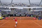 Serbia's Novak Đjoković serves the ball to Argentina's Diego Sebastián Schwartzman during their final match at the Italian Open tennis tournament, in Rome, Monday, Sept. 21, 2020. (Alfredo Falcone/LaPresse via AP)