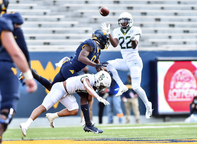 Baylor safety JT Woods (22) catches a interception against West Virginia during an NCAA college football game, Saturday, Oct. 3, 2020, in Morgantown, W.Va. (William Wotring/The Dominion-Post via AP)