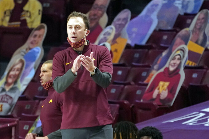Minnesota head coach Richard Pitino applauds his team in the second half of an NCAA college basketball game against Ohio State, Sunday, Jan. 3, 2021, in Minneapolis. (AP Photo/Jim Mone)