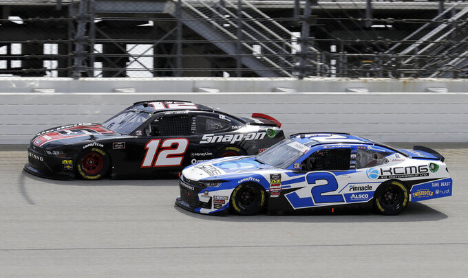 Joey Logano, left, and Tyler Reddick drive during a NASCAR Xfinity Series auto race at Chicagoland Speedway in Joliet, Ill., Saturday, June 29, 2018. (AP Photo/Nam Y. Huh)