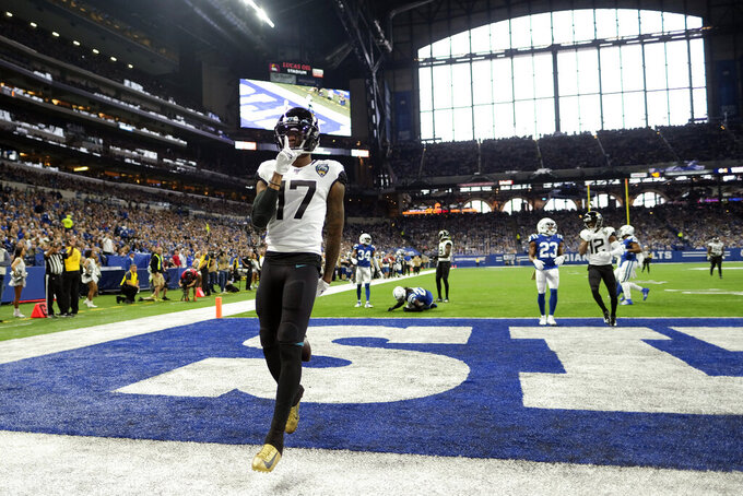 Jacksonville Jaguars' DJ Chark Jr. reacts after scoring a touchdown during the first half of an NFL football game against the Indianapolis Colts, Sunday, Nov. 17, 2019, in Indianapolis. (AP Photo/AJ Mast)