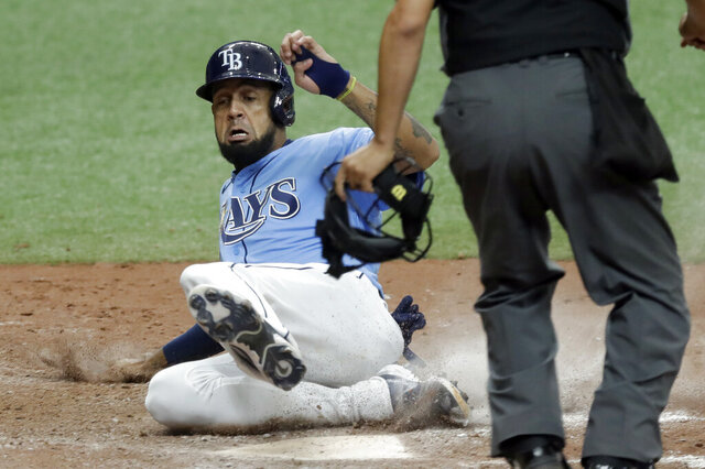 FILE - In this Sunday, July 26, 2020 file photo, Tampa Bay Rays' Jose Martinez scores the game-winning run on a two-run, walk-off triple by Kevin Kiermaier off Toronto Blue Jays relief pitcher Shun Yamaguchi during the 10th inning of a baseball game in St. Petersburg, Fla.  José Martínez and the New York Mets agreed Thursday, Jan. 14, 2021 to a one-year contract that pays $1 million while he is in the major leagues and $225,000 while he's in the minors.(AP Photo/Chris O'Meara, File)