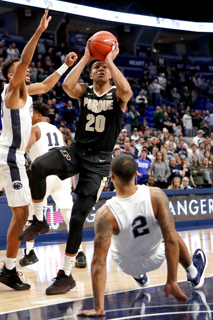 Purdue's Nojel Eastern (20) shoots as Penn State's Myles Dread (2) defends during the first half of an NCAA college basketball game Thursday, Jan. 31, 2019, in State College, Pa. (AP Photo/Keith Srakocic)
