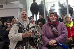 Relatives of victims of the Srebrenica genocide weep as they hear news on the decision of the UN appeals judges on former Bosnian Serb leader Radovan Karadzic in Potocari, Bosnia and Herzegovina, Wednesday, March 20, 2019. United Nations appeals judges on Wednesday upheld the convictions of Karadzic for genocide, war crimes and crimes against humanity, and increased his sentence from 40 years to life imprisonment. (AP Photo/Marko Drobnjakovic)