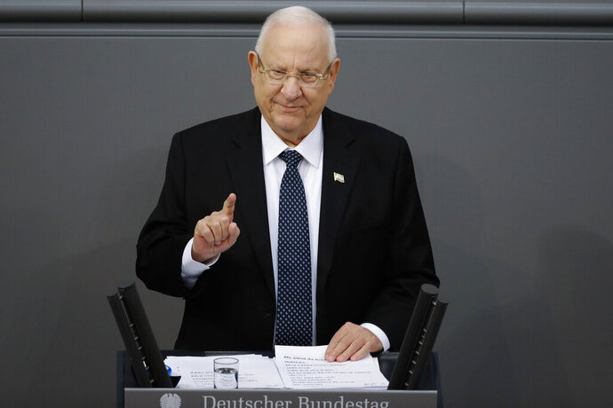 FILE - In this Jan. 29, 2020 file photo, Israel's President Reuven Rivlin delivers a speech during a special meeting of the German Parliament Bundestag commemorating the victims of the Holocaust, in Berlin, Germany. Rivlin is urging the country's opposing blocs to find a way to come together. That call comes in the wake of Israel's third inconclusive election in less than a year. The president is responsible for choosing the prime minister-designate he thinks is most likely to form a stable government. (AP Photo/Markus Schreiber, File)