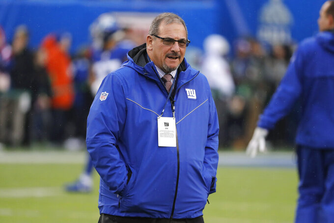 FILE - New York Giants general manager Dave Gettleman watches warm ups before an NFL football game against the Philadelphia Eagles, Sunday, Dec. 29, 2019, in East Rutherford, N.J. After three years of rebuilding and turning over the roster, general manager Dave Gettleman believes the young and feisty New York Giants are on the verge of being a competitive, winning team under new coach Joe Judge. Speaking on the record Wednesday, Sept. 2, 2020, for the first time since training camp opened last month, Gettleman believes the Giants have a solid young quarterback in Daniel Jones, a talented halfback in Saquon Barkley and some nice pieces on both sides of the ball.(AP Photo/Seth Wenig, File)