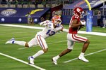Florida defensive back Donovan Stiner (13) is unable to stop Oklahoma wide receiver Marvin Mims (17) from reaching the end zone on a touchdown reception during the first half of the Cotton Bowl NCAA college football game in Arlington, Texas, Wednesday, Dec. 30, 2020. (AP Photo/Michael Ainsworth)