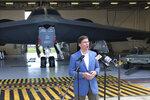 Defense Secretary Mark Esper speaks at Whiteman Air Force Base, Wednesday, July, 22, 2020  in Johnson County, Missouri. Esper is standing in front of a B-2 stealth bomber in a hangar at Whiteman. (AP Photo/Robert Burns)