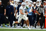 North Carolina quarterback Sam Howell (7) runs for a first down during the first half of an NCAA college football game against Georgia Tech, Saturday, Sept. 25, 2021, in Atlanta. (AP Photo/John Bazemore)