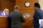 Judge Corey Amanda Cawthon speaks with defense attorneys Lorne Berkeley, left, and Eric Schwartzreich,  representing NFL free agent Antonio Brown during a first appearance hearing, Friday, Jan. 2,4 0202, at the Broward County Courthouse in Fort Lauderdale, Fla. Brown was granted bail on Friday after turning himself in at a Florida jail on charges that he and his trainer attacked the driver of a moving truck that carried some of his possessions from California.  (Amy Beth Bennett/South Florida Sun Sentinel via AP, Pool)