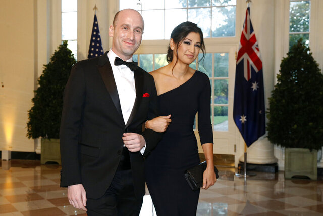 FILE - In this Sept. 20, 2019, file photo President Donald Trump's White House Senior Adviser Stephen Miller, left, and Katie Waldman, now Miller, arrive for a State Dinner with Australian Prime Minister Scott Morrison and President Donald Trump at the White House in Washington. Vice President Mike Pence's press secretary has the coronavirus, the White House said Friday, making her the second person who works at the White House complex known to test positive for the virus this week.Pence spokeswoman Katie Miller, who tested positive Friday, May 8, 2020, had been in recent contact with Pence but not with the president. (AP Photo/Patrick Semansky, File)